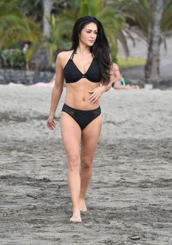 Casey Batchelor In black bikini filming in Tenerife for her fitness app Yoga Blitz 03