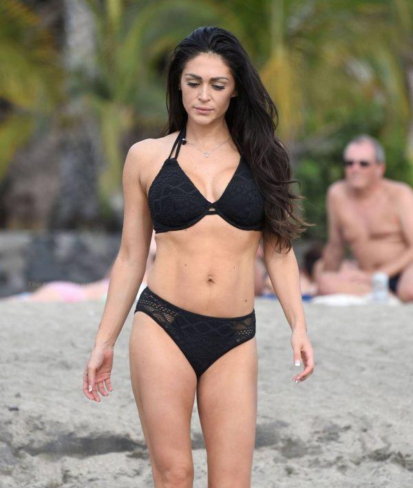 Casey Batchelor In black bikini filming in Tenerife for her fitness app Yoga Blitz 06