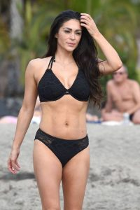 Casey Batchelor In black bikini filming in Tenerife for her fitness app Yoga Blitz 07
