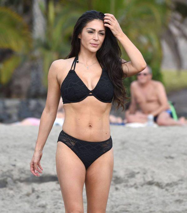 Casey Batchelor In black bikini filming in Tenerife for her fitness app Yoga Blitz 07