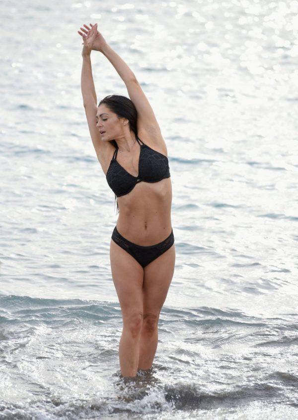 Casey Batchelor In black bikini filming in Tenerife for her fitness app Yoga Blitz 08