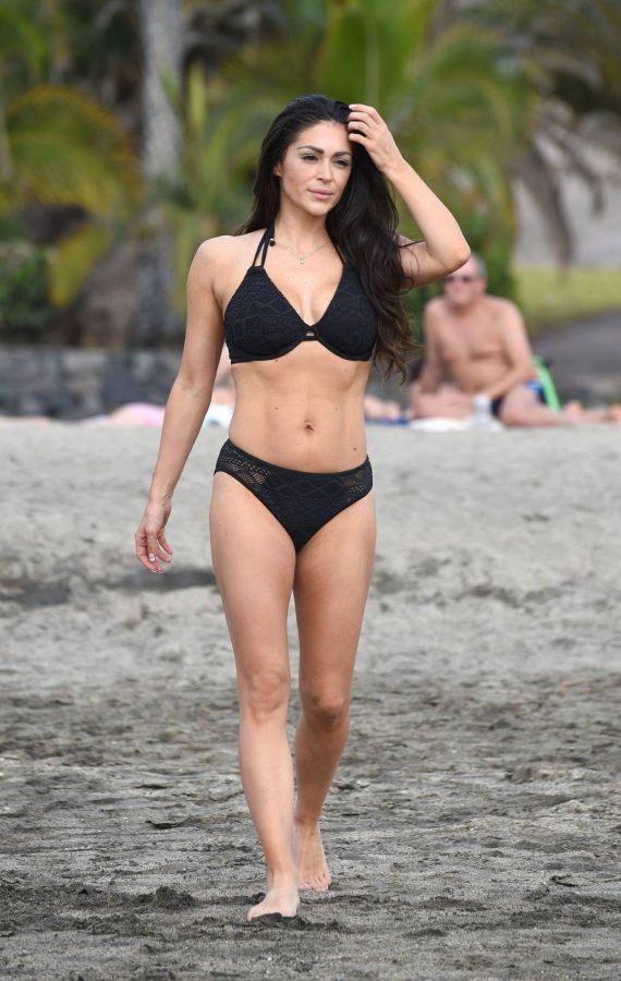 Casey Batchelor In black bikini filming in Tenerife for her fitness app Yoga Blitz 11