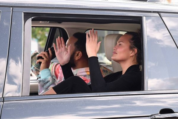 John Legend and Chrissy Teigen celebrate the Joe Bidens win while riding around in West Hollywood 01
