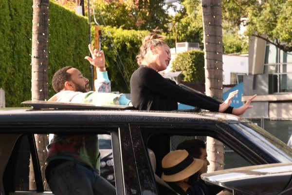 John Legend and Chrissy Teigen celebrate the Joe Bidens win while riding around in West Hollywood 02