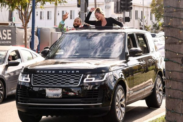 John Legend and Chrissy Teigen celebrate the Joe Bidens win while riding around in West Hollywood 03