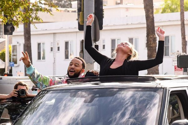 John Legend and Chrissy Teigen celebrate the Joe Bidens win while riding around in West Hollywood 04