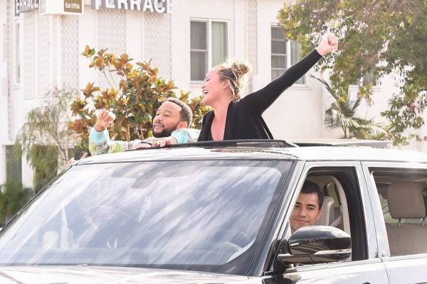 John Legend and Chrissy Teigen celebrate the Joe Bidens win while riding around in West Hollywood 05