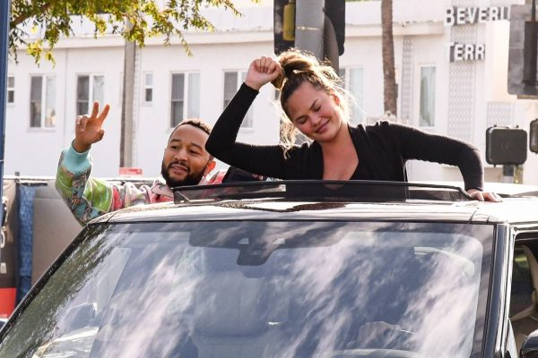 John Legend and Chrissy Teigen celebrate the Joe Bidens win while riding around in West Hollywood 07