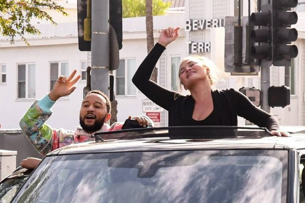 John Legend and Chrissy Teigen celebrate the Joe Bidens win while riding around in West Hollywood 08