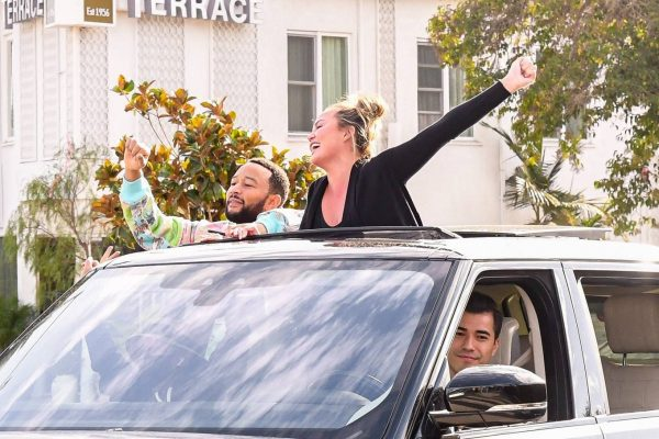 John Legend and Chrissy Teigen celebrate the Joe Bidens win while riding around in West Hollywood 09