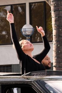 John Legend and Chrissy Teigen celebrate the Joe Bidens win while riding around in West Hollywood 10