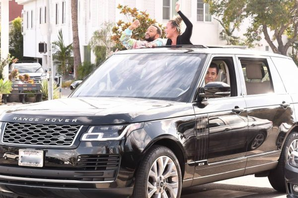 John Legend and Chrissy Teigen celebrate the Joe Bidens win while riding around in West Hollywood 11