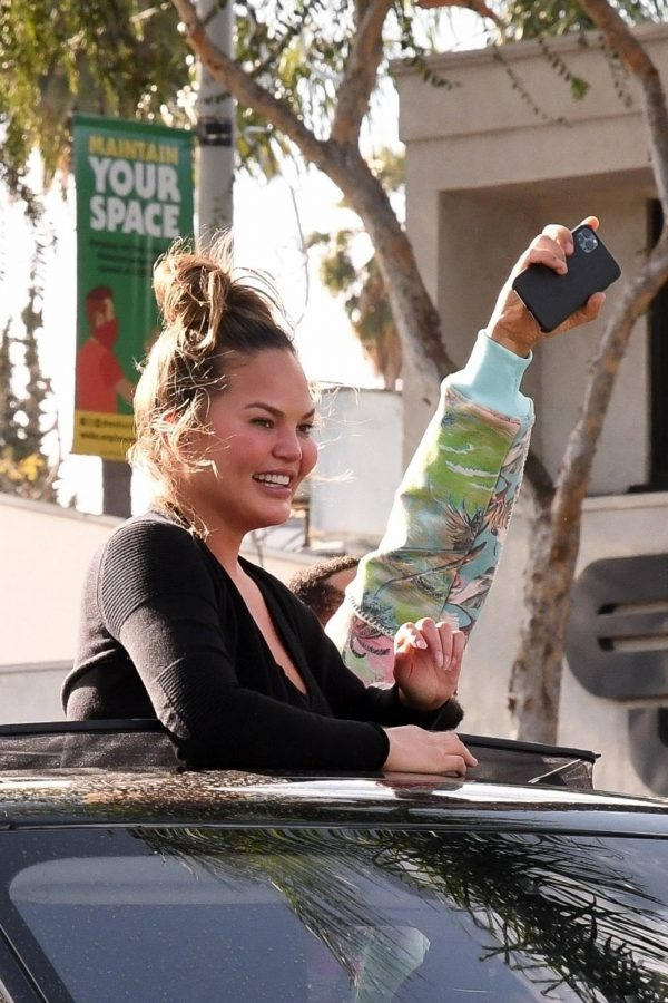 John Legend and Chrissy Teigen celebrate the Joe Bidens win while riding around in West Hollywood 15