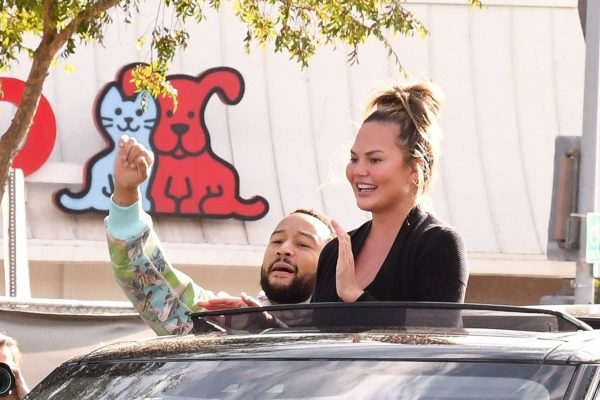 John Legend and Chrissy Teigen celebrate the Joe Bidens win while riding around in West Hollywood 16