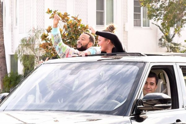 John Legend and Chrissy Teigen celebrate the Joe Bidens win while riding around in West Hollywood 17