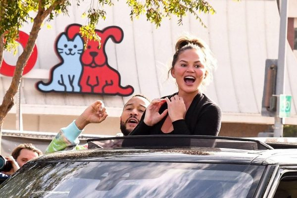 John Legend and Chrissy Teigen celebrate the Joe Bidens win while riding around in West Hollywood 18