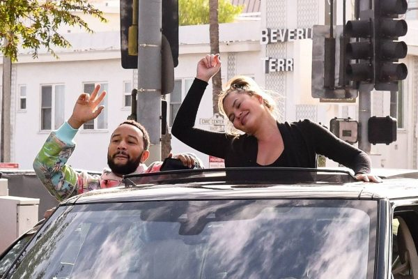 John Legend and Chrissy Teigen celebrate the Joe Bidens win while riding around in West Hollywood 22