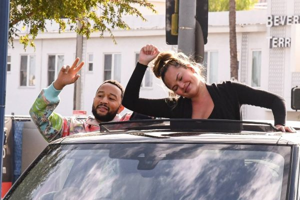 John Legend and Chrissy Teigen celebrate the Joe Bidens win while riding around in West Hollywood 23
