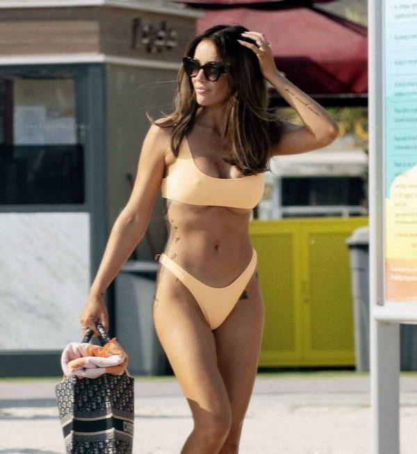 Laura Anderson In a orange bikini at the beach in Dubai 03
