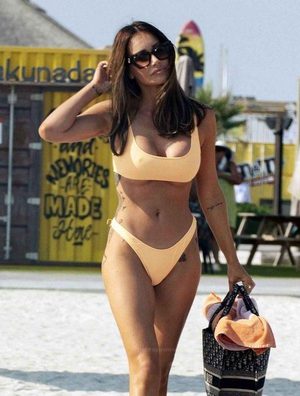 Laura Anderson In a orange bikini at the beach in Dubai 04