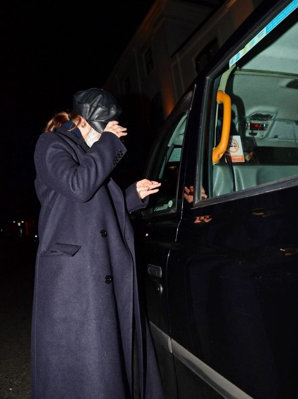 Lily James Hides from the cameras with Dominic Cooper in London 02