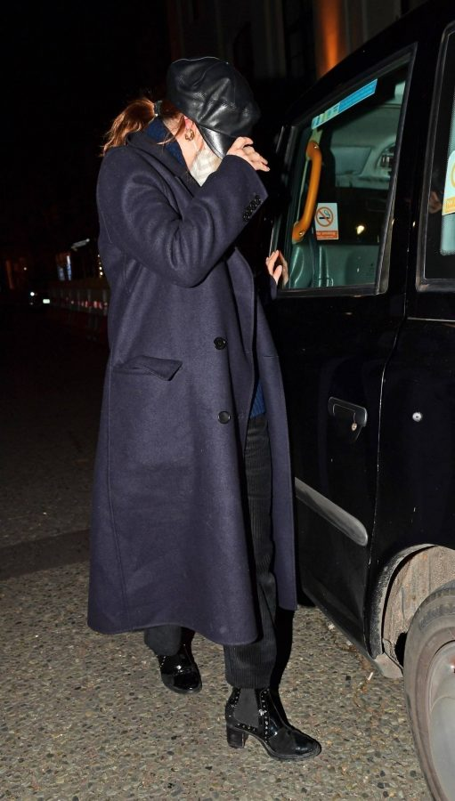 Lily James Hides from the cameras with Dominic Cooper in London 07