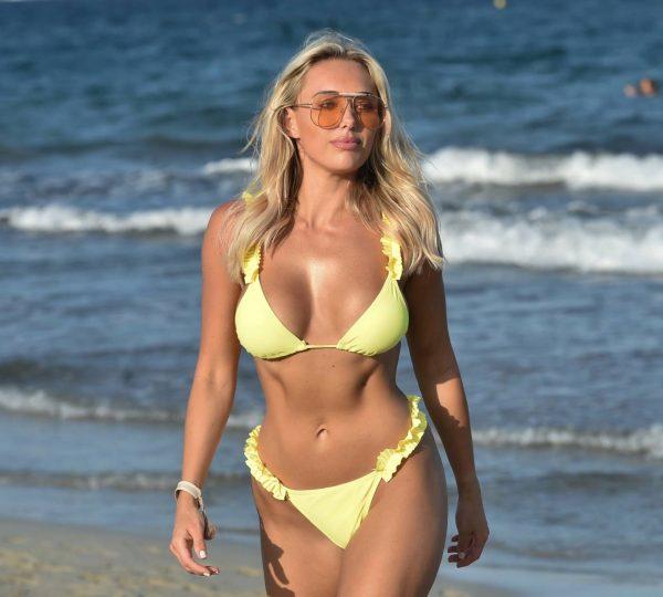 Amber Turner In yellow bikini on the beach in Crete 04
