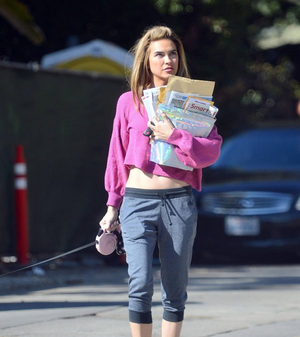 Chrishell Stause In a midriff bearing crop top in Los Angeles 01