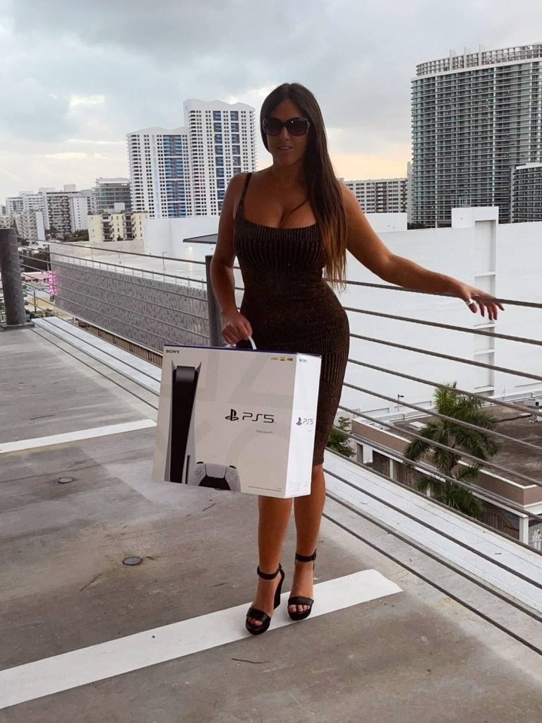 Claudia Romani Gets a PS5 in Miami Beach 05