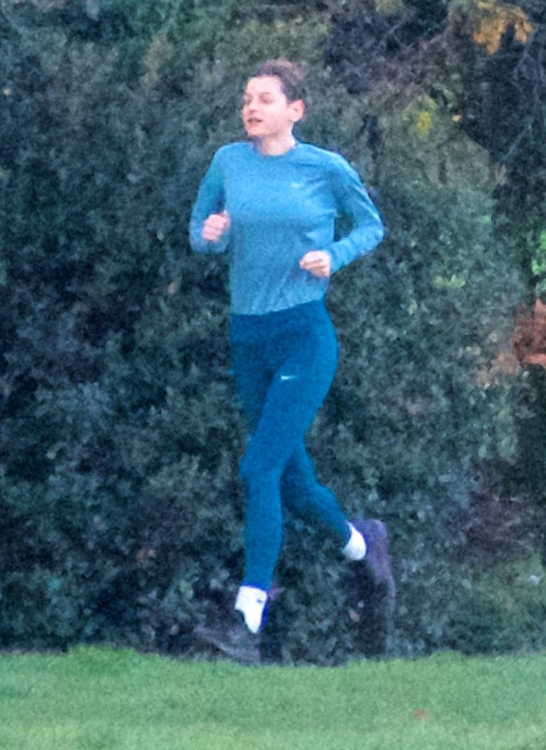 Emma Corrin Jogging candids at a park with a mystery male friend in London 02
