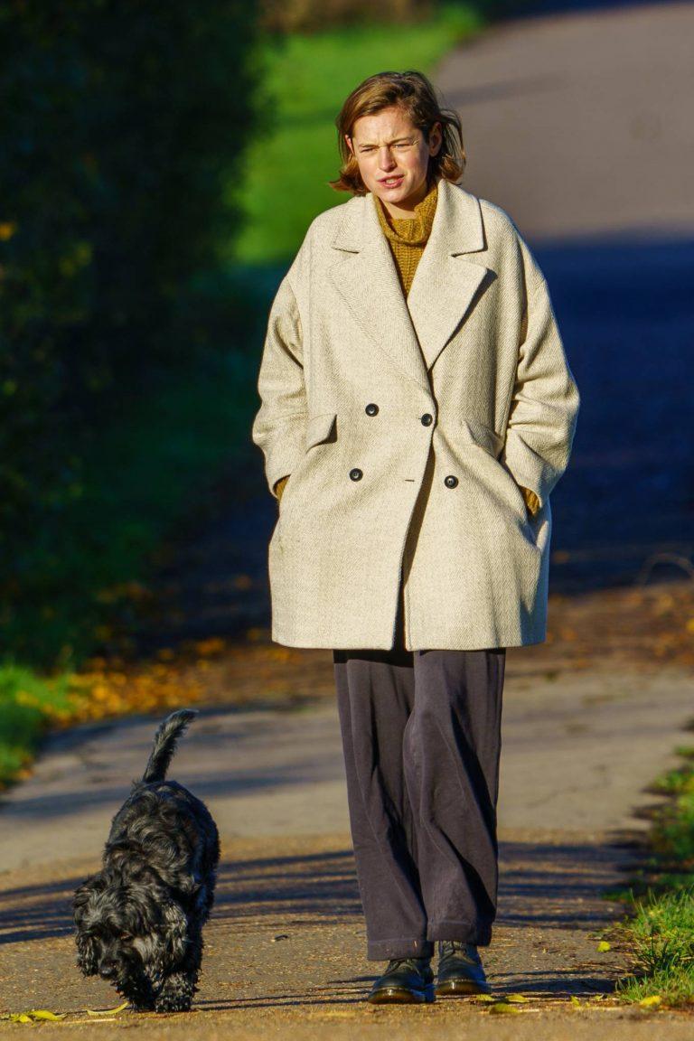 Emma Corrin walk with a male friend in North London 08