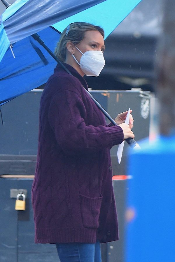 Hilary Duff Seen on the rain on the set of Younger in Westbury 01