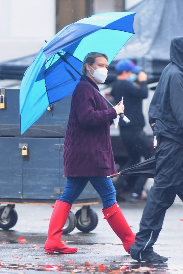 Hilary Duff Seen on the rain on the set of Younger in Westbury 04