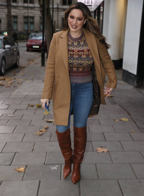 Kelly Brook in a tan overcoat with sweater at Heart radio in London 01