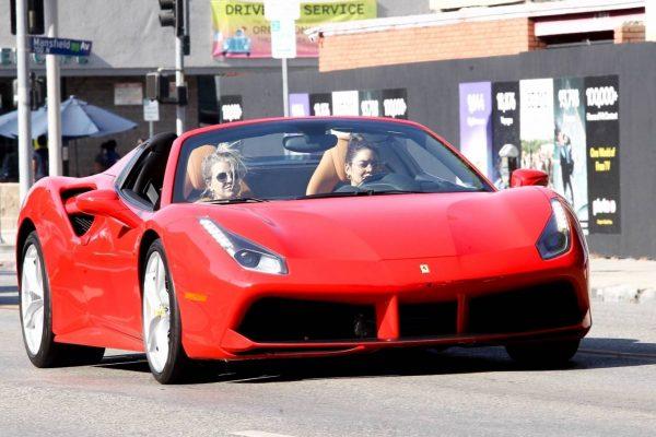 Vanessa Hudgens Leaving Dogpound gym in her red Ferrari 01