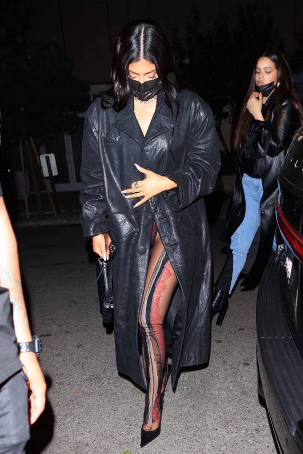 Kylie Jenner Wearing black trench coat while at The Nice Guy in West Hollywood 07